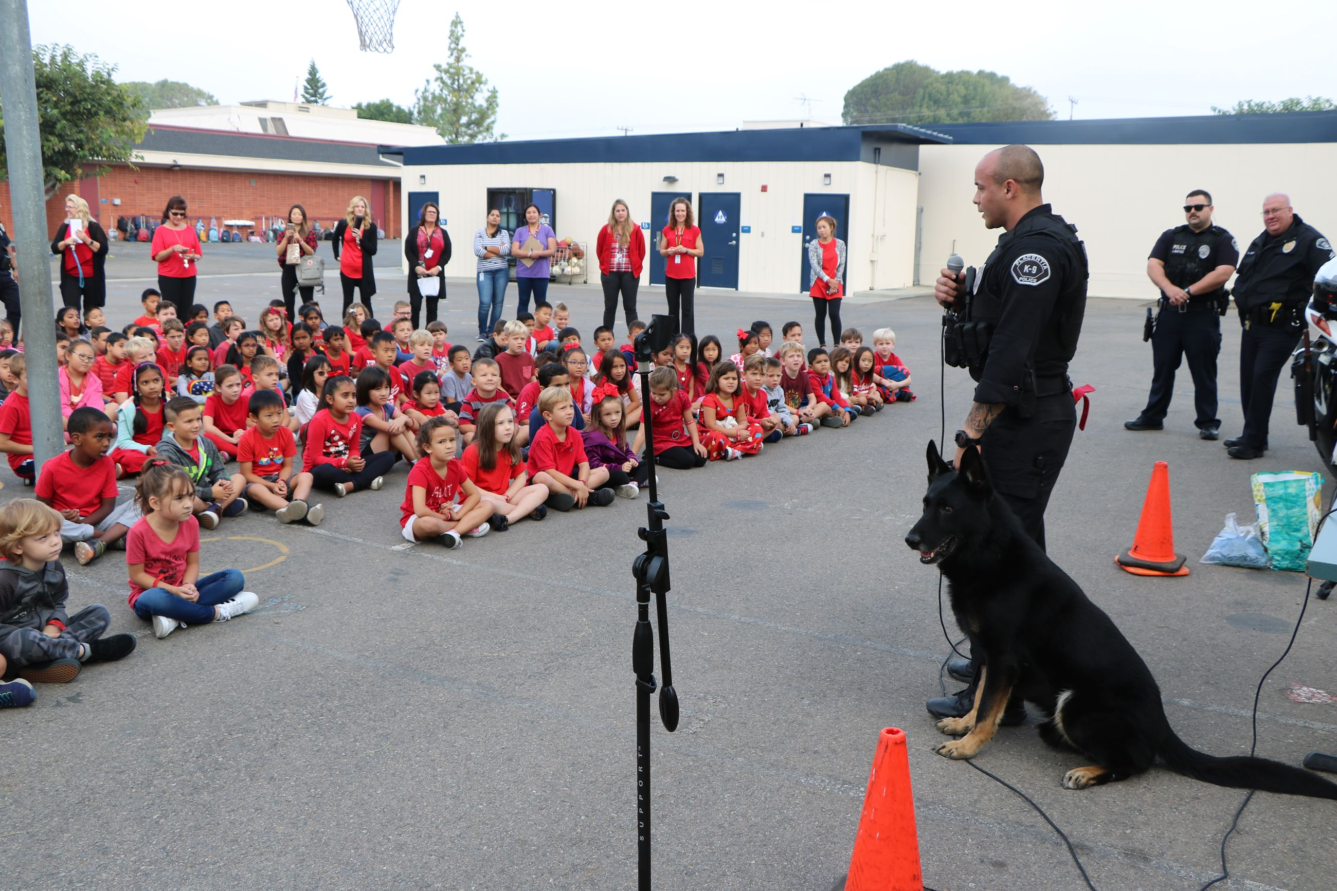 K-9 officer talking to children at Red Ribbon week event